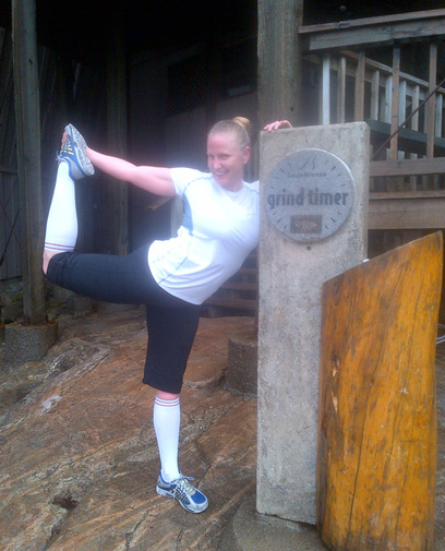 Jodi Eckland, stretching at the top of the Grouse Grind