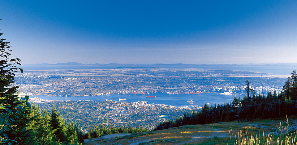 Summer view of Vancouver from the Cut at the top of Grouse Mountain