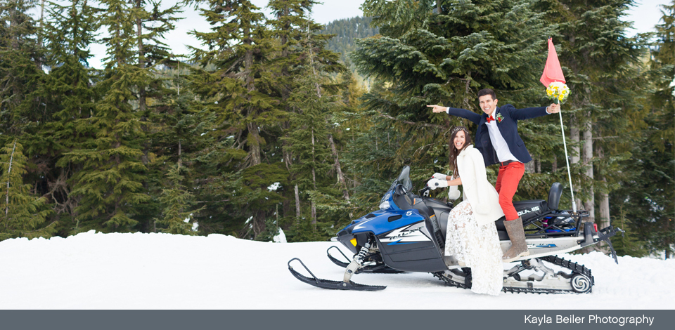 couple having fun on a snowmobile at Grouse Mountain on their wedding day