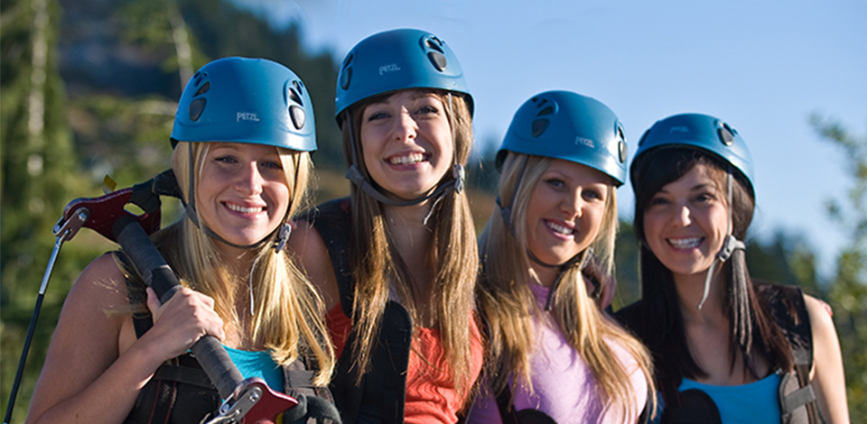 group of girls ziplining
