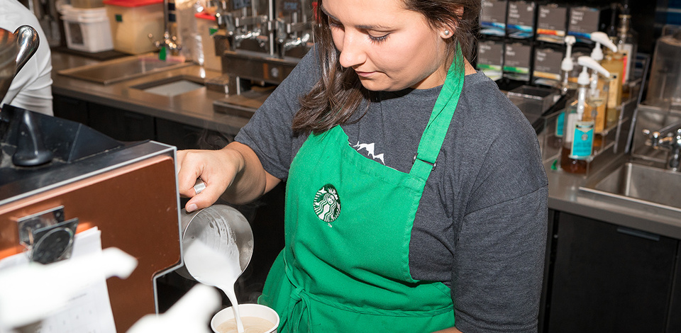 Staff making drink at Starbucks Grouse Mountain location.