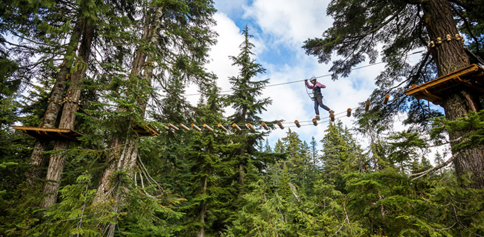 Walking across obstacles on Grouse Mountain's new aerial ropes course