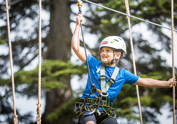 Boy on Grouse Mountain's new aerial ropes course
